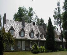 General view of Trestler House, showing the steeply pitched gable roof with dormers, extended eaves, and multiple chimneys, 2001.; Parks Canada Agency / Agence Parcs Canada, 2001.