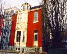 View of main facade, 32 Queen's Road, looking northward, prior to restoration.  Photo taken pre-1992.; HFNL 2007