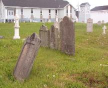 Partial view of Christ Church Churchyard Cemetery with the current Church Church building in the background, Bonavista, NL, 2006/06/14; L Maynard/HFNL 2006
