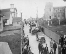Memorial Day parade on Church Street, Bonavista, NL circa 1947, with former stone Christ Church building and Churchyard Cemetery on the right; Dave Dunn - Bona Photo Media Gallery, Town of Bonavista web site: www.bonavista.net