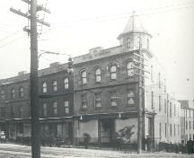Historic image showing the Grace Building , circa 1898-1913, while under the ownership of John Anderson, as indicated by the store sign. ; HFNL/ 2006