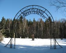 Showing metal entrance gate with sign; PEI Genealogical Society, 2008