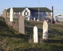 Photo view from Old Holy Trinity Parish Cemetery, looking east, facing Holy Trinity Primary and Elementary School, Torbay Road, Torbay, NL, 2006/05/10; L Maynard, HFNL, 2006