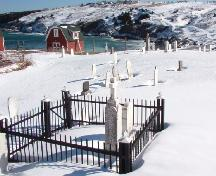 A portion of Old St. Nicholas Anglican Cemetery, Torbay, NL as seen from Lower Street, looking towards Torbay Beach, 2006/02/23.; Lara Maynard, HFNL, 2006.