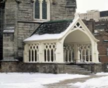 View of an entrance porch of St. Paul's Presbyterian Church / Former St. Andrew's Church, showing its steeply pitched roof and intricate woodwork, 1994.; Parks Canada Agency / Agence Parcs Canada, J. Butterill, 1994.