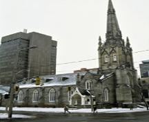 View of the side of St. Paul's Presbyterian Church / Former St. Andrew's Church, showing the tower with a striking stone spire, 1994.; Parks Canada Agency / Agence Parcs Canada, J. Butterill, 1994.