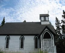 Side elevation showing main entrance, which faces the water,  St. John Evangelist Anglican Church, Bell Island, LaHave Islands, Lunenburg County, Nova Scotia, 2006.; Heritage Division, Nova Scotia Department of Tourism, Culture and Heritage, 2006