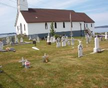 Topsail United Church Cemetery, 2424 Conception Bay Highway, Topsail, Conception Bay South, with Topsail United Church in background, July 2004.; Heritage Foundation of Newfoundland and Labrador 2005