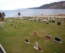 View of the cemetery with Conception Bay in the background. Photo taken 2006.; HFNL 2009