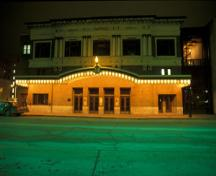General nighttime view of Pantages Playhouse theatre, 1995.; Parks Canada/Parcs Canada, 1995.