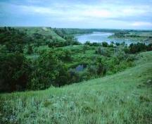 View of Opimihaw Valley at its confluence with the South Saskatchewan River, 1991.; Government of Saskatchewan, Frank Korvemaker, 1991.