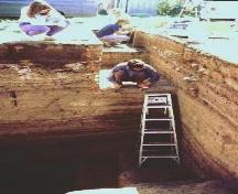 Open excavation unit showing stratified occupation layers.; Government of Saskatchewan.