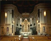 Interior view of St. John the Baptist Anglican Cathedral, showing the nave from the choir, 1988.; Parks Canada Agency/ Agence Parcs Canada, 1988.