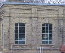 Featured is the decorative brickwork and concrete keystones over the windows, 2007.; Lindsay Benjamin, 2007.