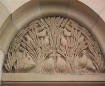 Showing detail of carving above entrance; MacNaught History Centre and Archives, Natalie Griffith, 2005