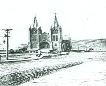 General view of St. Patrick, showing its location, slightly set back from the street, 1914.; Parks Canada Agency / Agence Parcs Canada, 1914.