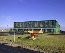 Contextual view, from the west, of the Commonwealth Air Training Plan Hangar, Brandon area, 2005; Historic Resources Branch, Manitoba Culture, Heritage, Tourism and Sport, 2005