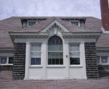 This photograph shows the palladian window in the central dormer and the pilasters that divide the openings, 2007; Town of St. Andrews
