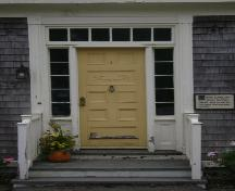 This photograph shows the wood door, transom window and sidelights, 2007; Town of St. Andrews