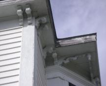 This photograph illustrates the decorative brackets and pendants under the eaves, 2008; Town of St. Andrews
