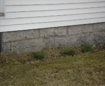 This photograph illustrates the foundation stones that were cut and laid by the original occupant, 2008; Town of St. Andrews