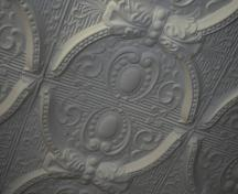 Interior view of a tin ceiling detail in the H.P. Tergesen and Sons General Merchant, Gimli, 2005; Historic Resources Branch, Manitoba Culture, Heritage, Tourism and Sport,  2005