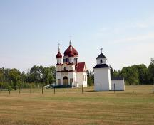 Contextual view, from the west, of the Ukrainian Catholic Church of the Immaculate Conception, Winnipegosis, 2006; Historic Resources Branch, Manitoba Culture, Heritage and Tourism, 2006