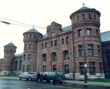 Corner view of the Halifax Drill Hall, showing the Cunard Street façade, 1990.; Department of National Defence/ Ministère de la Défence nationale, 1990.