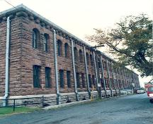 Corner view of a façade of the Halifax Drill Hall, 1990.; Department of National Defence/ Ministère de la Défence nationale, 1990.