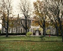 General view of Government House, showing the central entrance under a projecting portico, 1993.; Parks Canada Agency / Agence Parcs Canada, 1993.