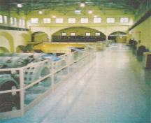 View of the station's interior at Stave Falls Hydro-Electric Installation, showing its open space and mezzanine gallery, 2002.; Agence Parcs Canada / Parks Canada Agency, 2002.