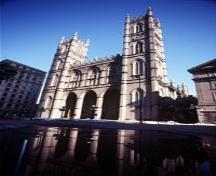 View of the façade of the Notre-Dame Roman Catholic Church / Basilica; Parks Canada/Parcs Canada, 1993.