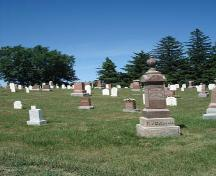 Of note is the row of white spruce trees on the eastern boundary of the cemetery.; Kendra Green, 2007.
