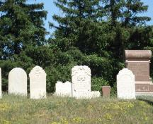 Featured are some of the gravestones marking the graves of early pioneers.; Kendra Green, 2007.