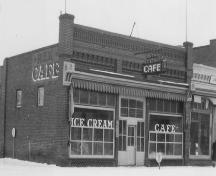 Archival view of the primary elevation of the Former Rex Cafe Site, the building that once occupied the present 125th Commemorative Park, Carberry, 1942.; Carberry Plains Archives, 1942