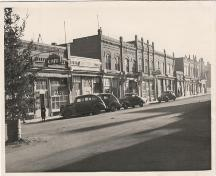 Archival view showing the Former Rex Cafe Site (far left), the building that once occupied the present 125th Commemorative Park, Carberry, 1944.; Carberry Plains Archives, 1944