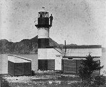 Rocky Point Light Station, circa1887, showing original attached structure and caretaker up by the light. ; Elliott Premises (Newman and Co. Photo Album) 2009