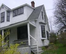 This photograph shows the side façade of the residence and illustrates the triangular bay window, 2009; Town of St. Andrews
