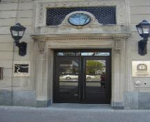 Featured is the Wellington Street entrance with projecting cornice.; Kendra Green, 2007.