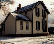 Rear view of Bell Homestead, showing its stucco finish, 1997.; Parks Canada Agency / Agence Parcs Canada, James De Jonge, 1997.