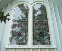 Window detail, east elevation, St. Peter's and St. John's, Baddeck, Nova Scotia, 2004. ; Heritage Division, NS Dept. of Tourism, Culture and Heritage, 2004.