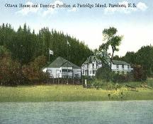 Ottawa House from the water during the period it was an inn, Partridge Island, NS, 1930.; Courtesy of the NSM History Collection, P112.27