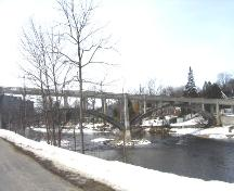 View of the bridge looking north from the walking trail beside Woolwich Street.; Mary Tivy, 2008.