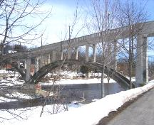 View of the bridge looking south from the walking trail beside Woolwich Street.; Mary Tivy, 2008.