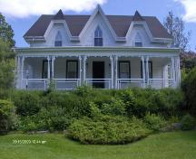 This photograph shows the contextual view of the rectory, 2009; Town of St. Andrews
