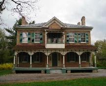 Of note are the symmetrical proportions of the main block and decorative Queen Anne style veranda.; Paul Dubniak, 2008.