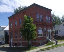 This photograph shows the contextual view of the corner building, 2009; Town of St. Andrews