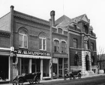 Archival view, from the southeast, of the Murphy Block (left), Carberry, ca. 1925; Carberry Plains Archives, ca. 1925