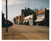 Archival view showing the early quality and condition of the west side of the Historic Downtown Carberry heritage district, Carberry, ca. 1944.; Historic Resources Branch, Manitoba Culture, Heritage, Tourism and Sport, 2008