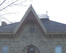 Featured are the decorative brackets and frieze adorning the gable.; Kayla Jonas, 2007.